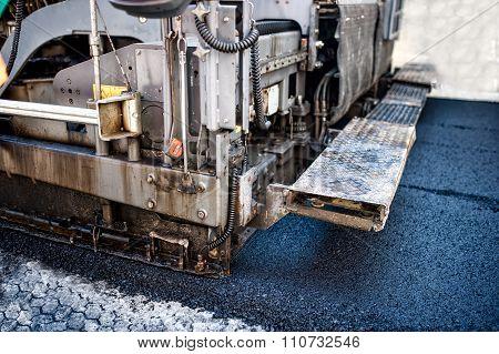 Pavement Machine Laying Fresh Asphalt Or Bitumen On Top Of The Gravel base