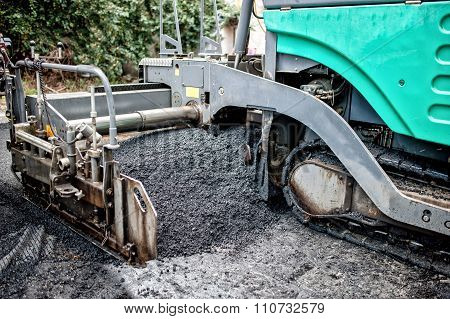 Detail Of Asphalt Paver Machine During Road Construction And Highway infrastructure