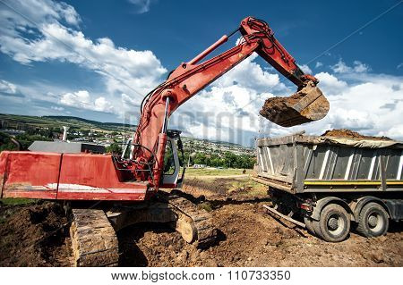Industrial Excavator Loading Soil Material From Highway Construction site