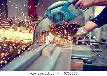 Industrial Engineer Working On Cutting A Metal And Steel With Compound mitre saw
