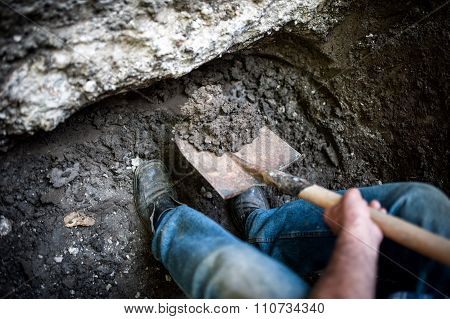 Man Digging A Hole In The Ground With Shovel And Spade