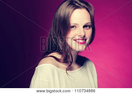 Woman Freckle Portrait On Color Background Red And Pink