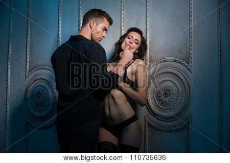 Two lovers under the wall of a beautiful interior