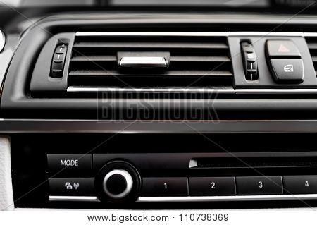 Modern Car Interior With Close-up Of Venitlation System Holes An