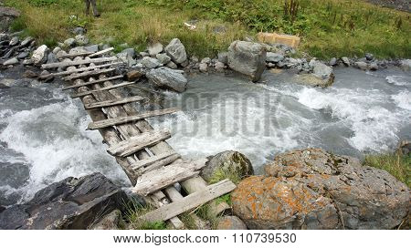 Old Timber Bridge At Mountain River