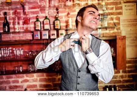 Portrait Of Angry And Stressed Bartender Or Barman With Bowtie