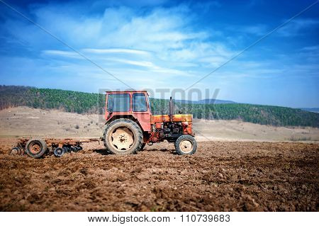 Agriculture And Harvesting - Vintage Tractor Plowing And Cultivating
