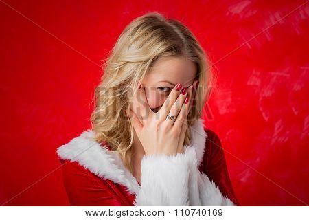 Woman hiding behind her hands