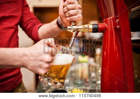 Barman Brewing A Draft, Unfiltered Beer At Pub Or Bar