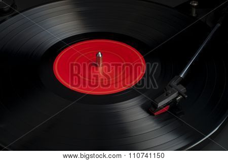 Old Turntable With A Vinyl