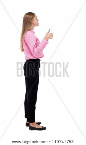 Back view of  woman thumbs up. Rear view people collection. backside view of person. Isolated over white background. She is a cancer and raised thumbs up approving.