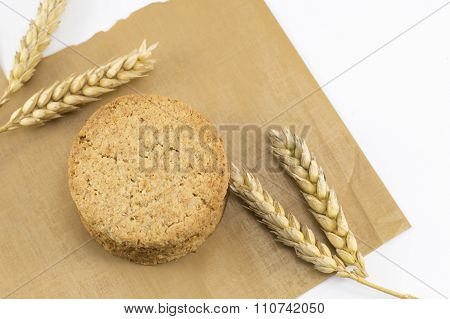 Integral Cookies And Wheat Plant On The Cooking Paper