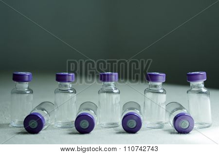 Several Empty Vials Placed In Line