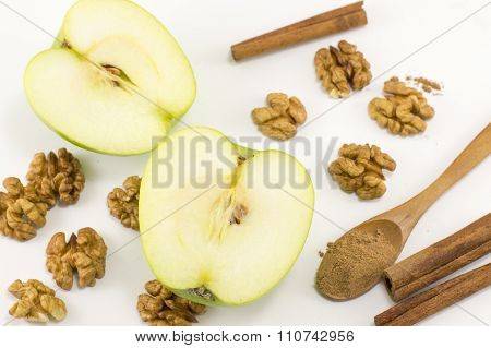 Walnuts, Cinnamon And Apples Scattered On The Table