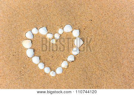 Sea Shell Heart On The Sand Beach