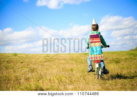 boy on a bicycle with a pile of gifts