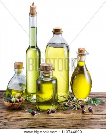 Olive oil and berries on the wooden table. white background. File contains clipping paths.