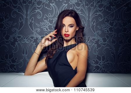 Sexy Seductive Woman With Red Lips Sitting On Sofa