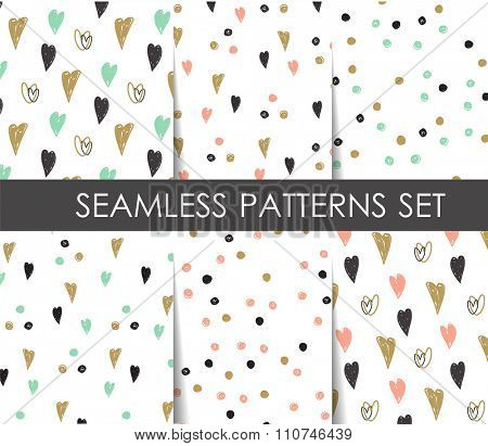 Black, white and gold hearts and dots seamless patterns set. Vector geometrical patterns.   Design  for paper, wallpaper, textile, fabric, and other projects.