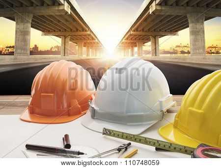 safety helmet on engineer working table