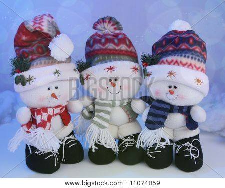 Three cute snowmen toys