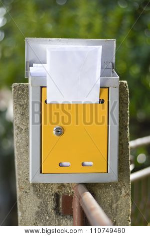 Open Mailbox With A Letter Shot With Low Depth Of Field