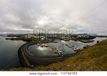 Stykkisholmur harbor in west Icelandic fjord with cityscape in background