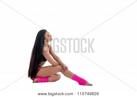 Sport fashion. Pretty brunette in pink gaiters
