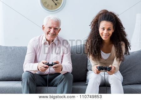 Holding Joysticks And Playing Games