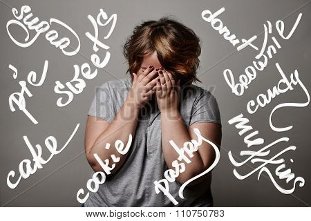 Plus Size Model Closed Her Face Ith Hands. With Different Type Of Pastery Words On The Foto