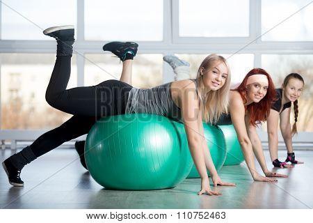 Group Of Women Doing Exercises On Balls