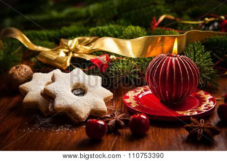 Christmas candle with sweet cookies