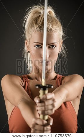 Sword In The Hands Of A Beautiful Woman