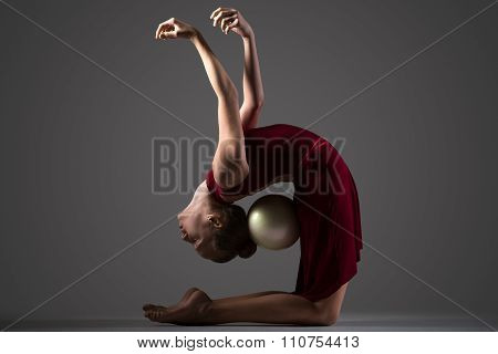 Gymnast Girl Bending Backwards With Ball