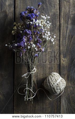 Bouquet Of Dried Flowers On Wooden Table