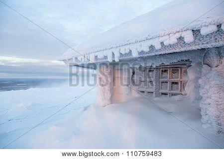Ice Frozen House In Finland Behind Polar Circle