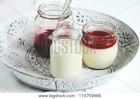 Panna cotta with red berry sauce