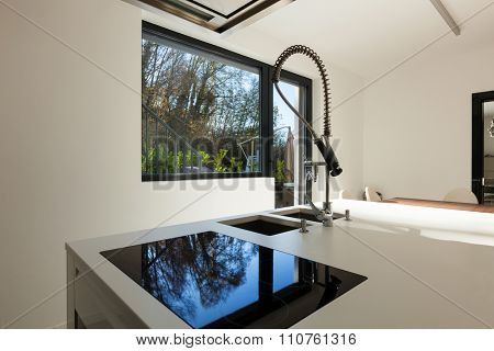 modern apartment, counter top of a domestic kitchen, hob