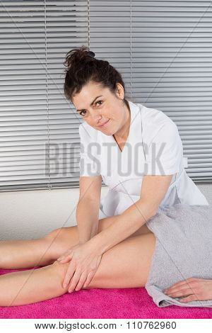 Close Up Detail Of Hands Massaging Female Hamstrings. Therapist Doing Manipulative Treatment On Uppe