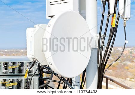 Antenna Radio Relay Station Of Cellular Communication On A Background Of Blue Sky
