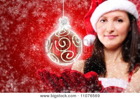 Portrait of a young girl dressed as Santa Claus