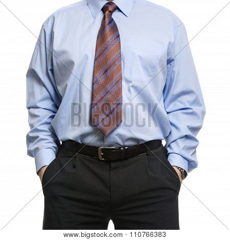 Businessman In Blue Shirt Standing With Hands In Pockets
