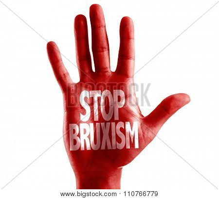 Stop Bruxism written on hand isolated on white background