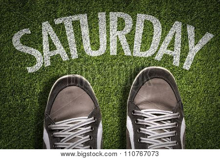 Top View of Sneakers on the grass with the text: Saturday