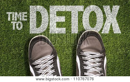 Top View of Sneakers on the grass with the text: Time to Detox