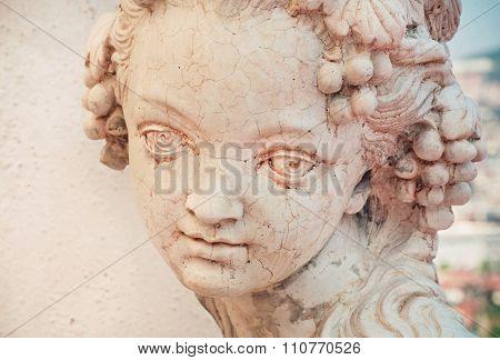 Girl Portrait In Stone. Copy Of Rustic Antique Sculpture