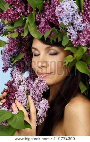 Beautiful Woman With Lilac Bouquet And Wreath
