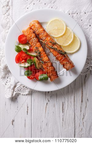 Grilled Salmon With Lemon And Fresh Salad On A Plate. Vertical Top View