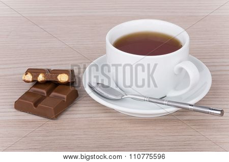 Cup Of Tea, Teaspoon And Chocolate Pieces