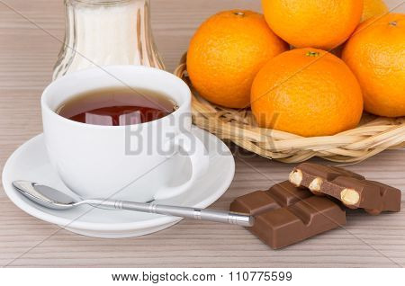 Cup Of Tea, Basket With Tangerines And Chocolate